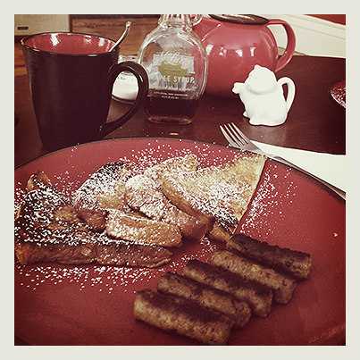 A hearty reward: snowstorm French toast with sausage and tea.